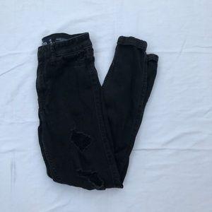 Women's ripped black skinny jeans